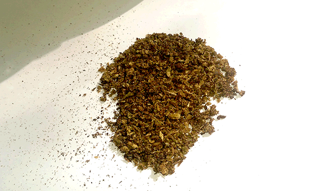 Already Vaped Bud or AVB with a nice brown color on white background